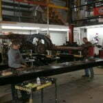 The guys disassembling the donor frame