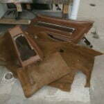 Old carpet, door panels, and consoles